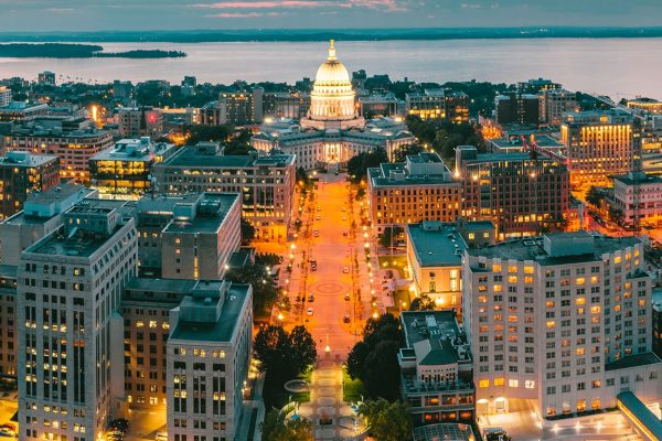 aerial shot at dusk of the Madison skyline with capitol and lake in background