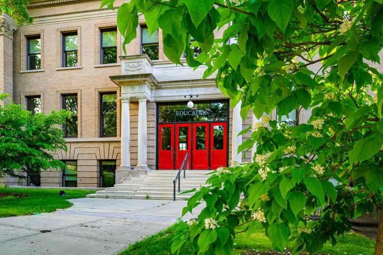 School of Education Building with red doors