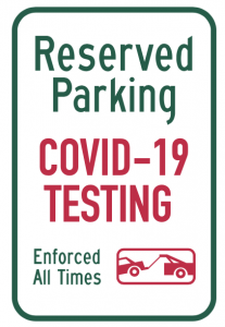 Parking sign with text reading Reserved Parking. COVID-19 Testing. Enforced at all times followed by icon showing car being towed.